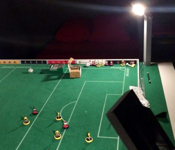 My DIY Subbuteo section: pitches, teams, storage cases, floodlights.